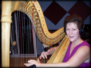 Martha Bush on harp at Eclipse Recording Studio