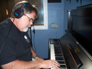 Jim Stafford of Eclipse Recording Company, on piano