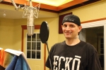 Hip Hop Artist, Pl Sqrd, laying down some vocal tracks.